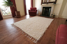 Hand made Spanish rug showing tassles